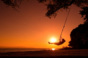 Beach swing at sunset, Pumulani, Lake Malawi